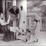 A British man gets a pedicure from an Indian servant.